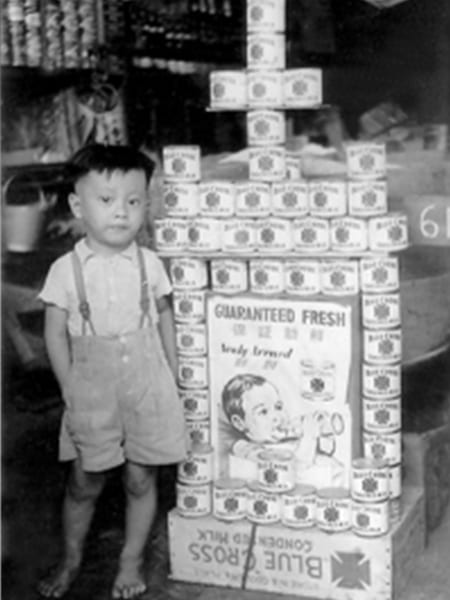 Young kid with cans.