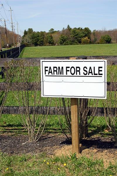 Farm for sale sign.