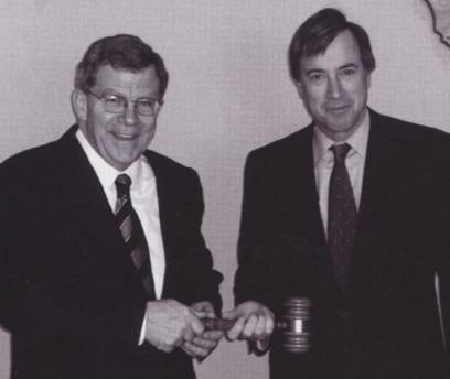 CEO Herb Tully congratulates John Thacher.