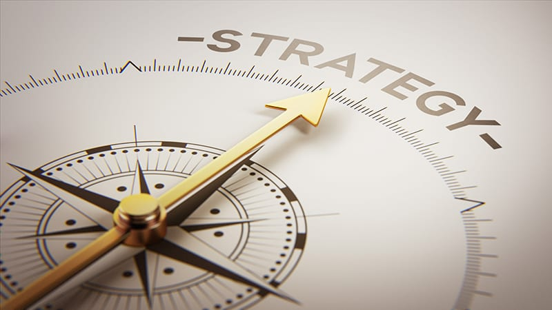 Compass pointing to word strategy.